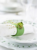 A place-setting with napkin and napkin ring