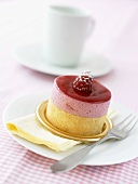 Petit four with raspberry cream