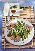 Salad with roast duck breast and plum sauce