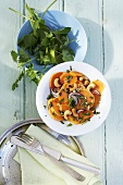 Sweet potato salad with herbs, cashew nuts and ginger dressing