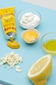 Mustard, onions, lemon, egg yolk and sour cream