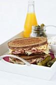 Reuben sandwich: cheese, corned beef and sauerkraut