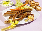 Grilled sausages with celery and carrots