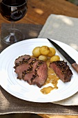 Venison steaks with pepper crust & boiled potatoes