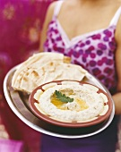Hummus in dish with flatbread