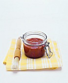 BBQ sauce in jar with brush