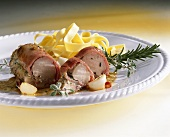 Rolled ham-wrapped rabbit fillet with ribbon pasta