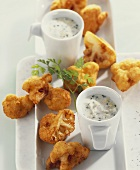 Cauliflower fritters with herb and egg sauce