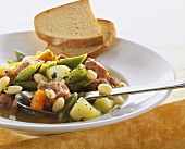 Cured pork with beans and vegetables