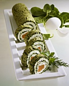 Spinach roulade with soft cheese and salmon filling