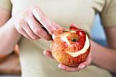 Peeling an apple with a knife
