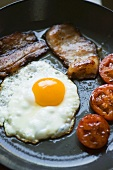 Frying English breakfast in a frying pan