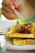 Spreading jam on toast