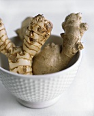 A ginger root and a galanga root