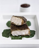 Spicy cod steaks with tamarind sauce and herbs