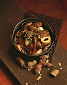 Asian meat stew with shallots and tamarinds