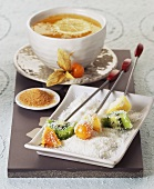 Skewered fruit with grated coconut and lemon tea
