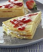Pancake cake with strawberry jam and vanilla cream