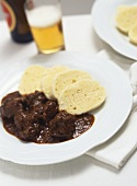 Wiener Saftgulasch (Viennese goulash) with yeast dumpling