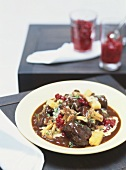 Venison ragout with cranberries & mashed potato with celery