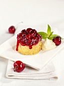 Small sponge cake with cherry topping