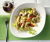 Fried strips of turkey breast on vegetables