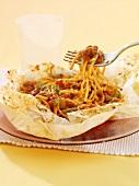 Spaghetti al cartoccio (spaghetti with tomato sauce in paper)