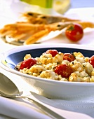 Risotto with scampi and cocktail tomatoes