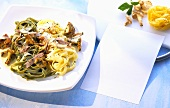 Green & white ribbon pasta with ham & chanterelle sauce