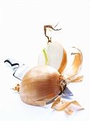 Halved onion with knife