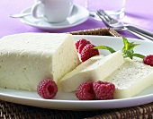 Soft cheese pudding with fresh raspberries