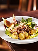Salad leaves with duck confit and fried potatoes