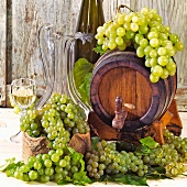 Still life with wine barrel and fresh grapes