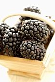 Blackberries in a small wooden basket