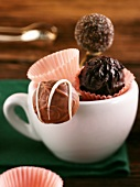 Three chocolate truffles in a cup