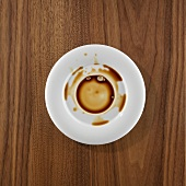 Saucer with spilt coffee