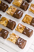 Almond slices half coated in chocolate