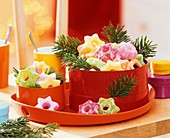 Sour fruit jelly sweets in tins with fir sprigs
