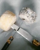 Two goat's cheeses speared on knives