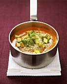 Tomato and pepper soup with avocado and rice