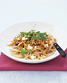 Ribbon pasta with mince and carrot sauce and goat's cheese