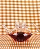 Brewed tea in a glass teapot