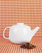 White teapot and tea mixture