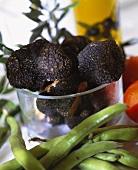 Black summer truffles in a glass bowl