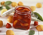 Strawberry and apricot jam in a jar