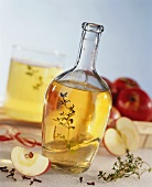 Apple vinegar with thyme in a bottle