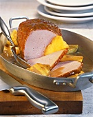 Smoked pork loin (Kassler) with honey crust and pineapple