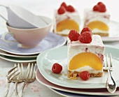 Cheesecake slices with peach and raspberries