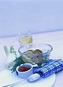 Artichokes in a bowl, saffron threads and herbs