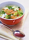 Potato and leek soup with salmon and bacon